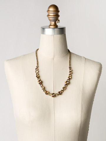 Graduated Classic Necklace in Antique Gold-tone Neutral Territory displayed on a necklace bust