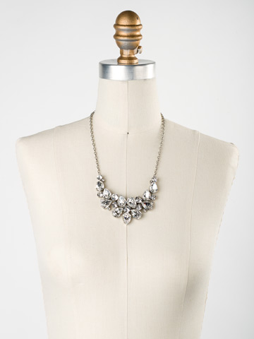 Dare To Pear Crystal Bib Necklace in Antique Silver-tone Crystal displayed on a necklace bust
