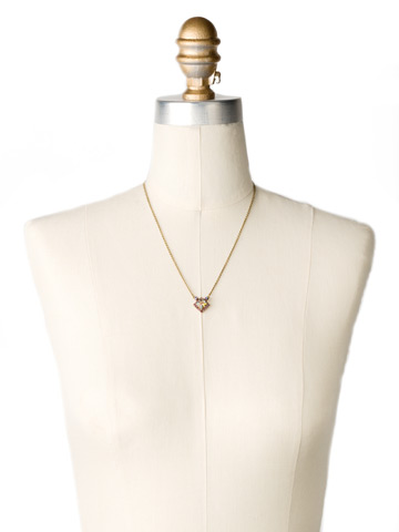 Perfectly Pointed Pendant Necklace in Antique Gold-tone Volcano displayed on a necklace bust