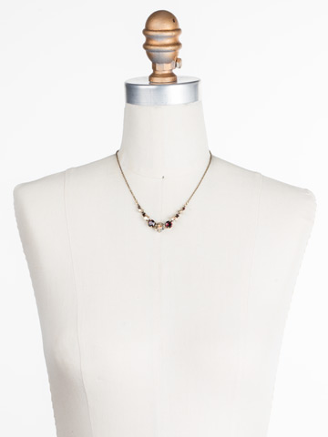 Delicate Round Crystal Necklace in Antique Gold-tone Mighty Maroon displayed on a necklace bust