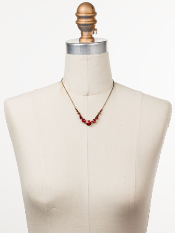 Delicate Round Crystal Necklace in Antique Gold-tone Sansa Red displayed on a necklace bust
