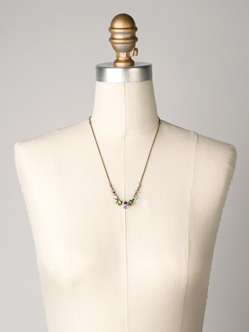 Delicate Round Crystal Necklace in Antique Gold-tone Spring Rain displayed on a necklace bust