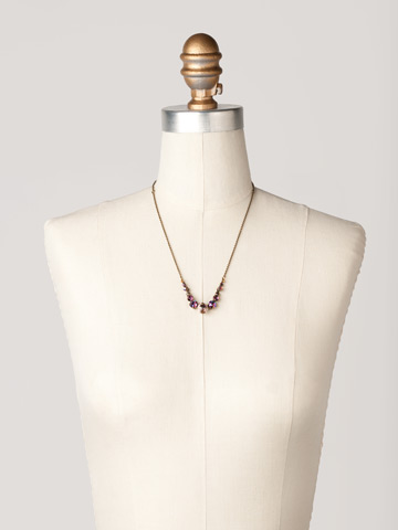 Delicate Round Crystal Necklace in Antique Gold-tone Sundance displayed on a necklace bust