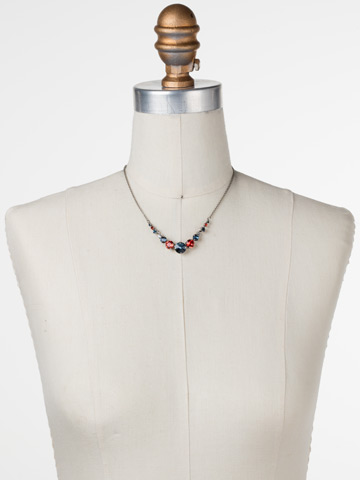 Delicate Round Crystal Necklace in Antique Silver-tone Battle Blue displayed on a necklace bust