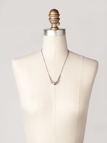 Delicate Round Crystal Necklace in Antique Silver-tone Cupcake displayed on a necklace bust