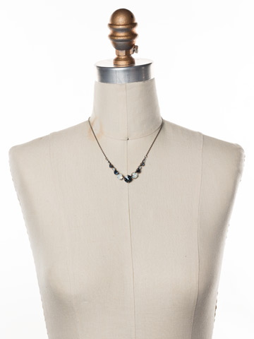 Delicate Round Crystal Necklace in Antique Silver-tone Glory Blue displayed on a necklace bust