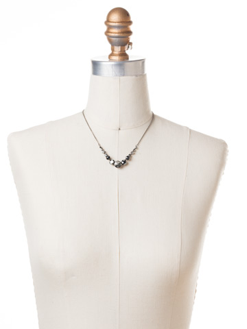 Delicate Round Crystal Necklace in Antique Silver-tone Midnight Moon displayed on a necklace bust