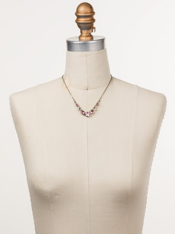 Delicate Round Crystal Necklace in Antique Silver-tone Misty Pink displayed on a necklace bust
