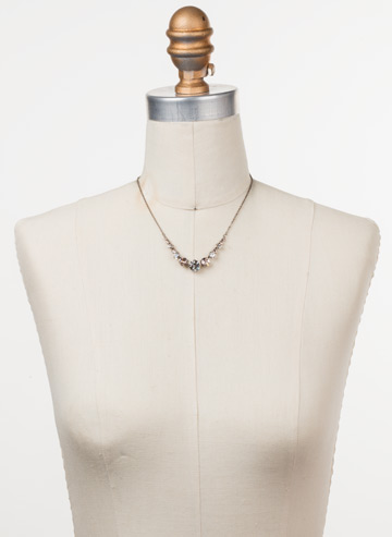 Delicate Round Crystal Necklace in Antique Silver-tone Soft Petal displayed on a necklace bust