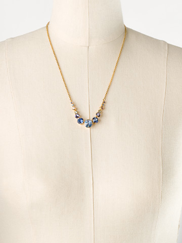 Delicate Round Crystal Necklace in Bright Gold-tone Sweet Sapphire displayed on a necklace bust