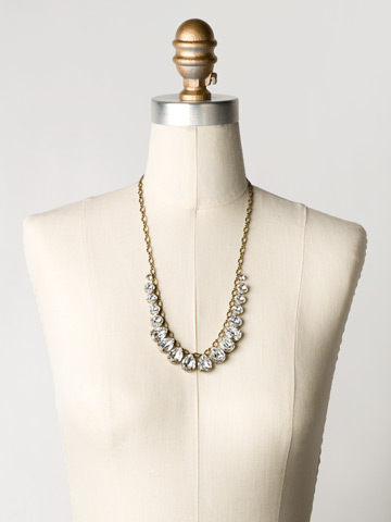 Peared to Perfection Necklace in Antique Gold-tone Crystal Clear displayed on a necklace bust