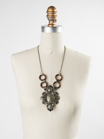 Semi-Precious Medallion Statemenet Bib in Antique Silver-tone Black and White displayed on a necklace bust