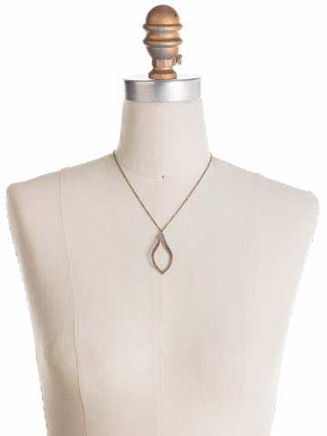 Openwork Crystal Pendant Necklace in Antique Gold-tone Crystal Patina displayed on a necklace bust
