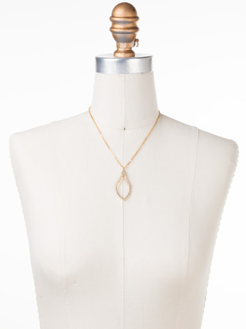 Openwork Crystal Pendant Necklace in Bright Gold-tone Crystal displayed on a necklace bust