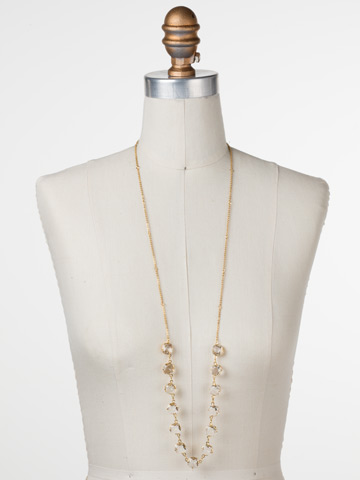 Crystal Rain Long Strand Necklace in Bright Gold-tone Crystal displayed on a necklace bust