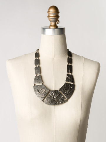 Embellished Metal Shield Necklace in Antique Silver-tone Crystal Clear displayed on a necklace bust