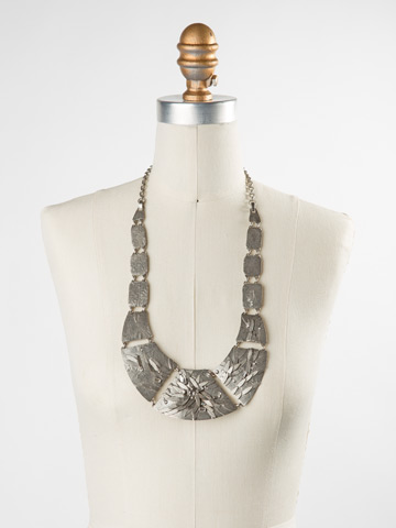 Embellished Metal Shield Necklace in Antique Silver-tone Crystal displayed on a necklace bust