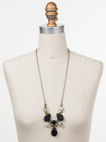 Teardrop Triangle Bib Necklace in Antique Silver-tone Heavy Metal displayed on a necklace bust