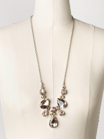 Teardrop Triangle Bib Necklace in Antique Silver-tone Satin Blush displayed on a necklace bust