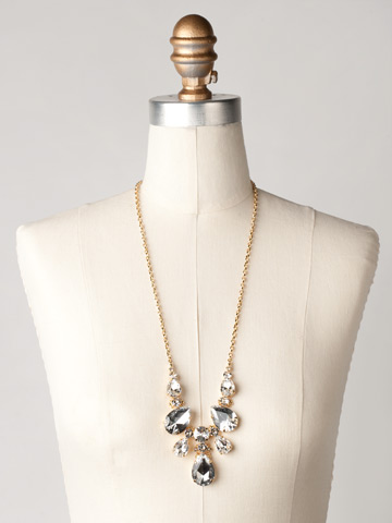 Teardrop Triangle Bib Necklace in Bright Gold-tone Crystal Clear displayed on a necklace bust