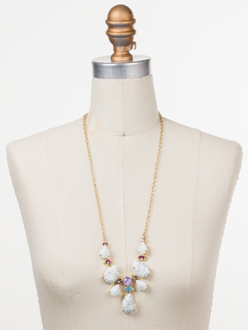 Teardrop Triangle Bib Necklace in Bright Gold-tone Precious Bright displayed on a necklace bust