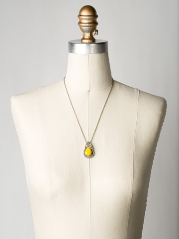 Pear Cut Crystal Pendant Necklace in Antique Silver-tone Lemon Zest displayed on a necklace bust