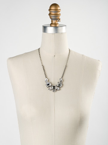 Emerald and Pear-Cut Crystal Collar Necklace in Antique Silver-tone Crystal displayed on a necklace bust