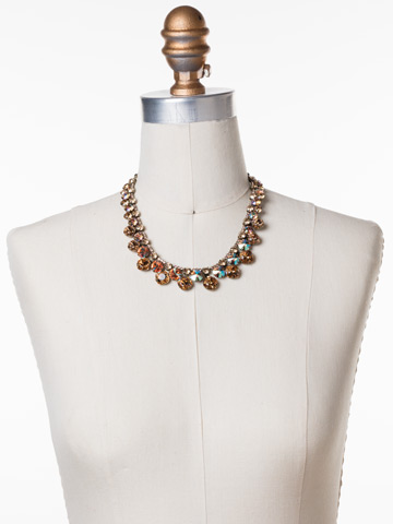 Cushion Cut Crystal Statement Collar Necklace in Antique Gold-tone Neutral Territory displayed on a necklace bust