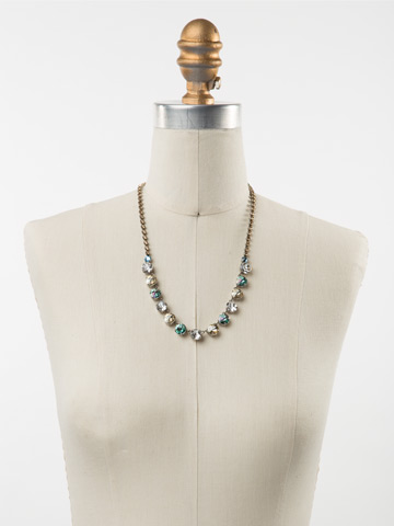 Repeating Rivoli Classic Line Necklace in Antique Silver-tone Eggshell displayed on a necklace bust