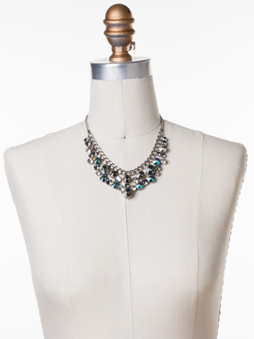 Round Crystal Cluster Bib Necklace in Antique Silver-tone Crystal Rock displayed on a necklace bust