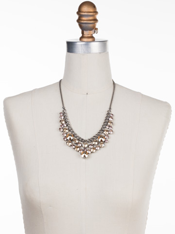 Round Crystal Cluster Bib Necklace in Antique Silver-tone Satin Blush displayed on a necklace bust