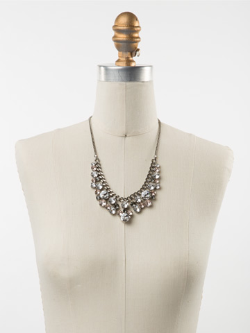 Round Crystal Cluster Bib Necklace in Antique Silver-tone Snow Bunny displayed on a necklace bust