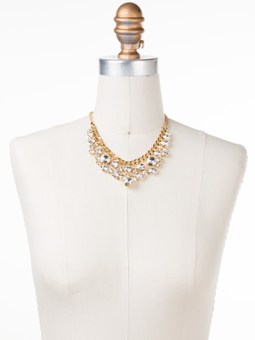 Round Crystal Cluster Bib Necklace in Bright Gold-tone Crystal displayed on a necklace bust