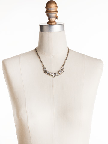 Multi-cut Round Crystal Cluster Line Necklace in Antique Gold-tone Crystal displayed on a necklace bust