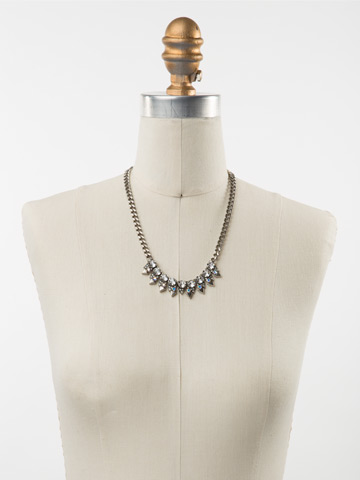 Crystal and Metal Spike Necklace in Antique Silver-tone White Bridal displayed on a necklace bust