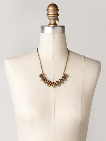 Pointed Crystal Oval Line Necklace in Antique Gold-tone Desert Sun displayed on a necklace bust