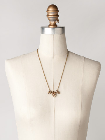 Triple Crystal Pointed Oval Pendant in Antique Gold-tone Desert Sun displayed on a necklace bust