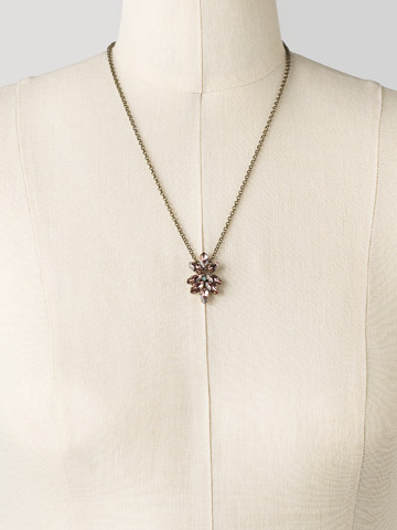 Delicate Floral Navette Crystal Pendant in Antique Gold-tone Sangria displayed on a necklace bust