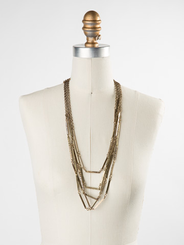 Linked Hammered Metal Multi-Strand Necklace in Antique Gold-tone Crystal displayed on a necklace bust