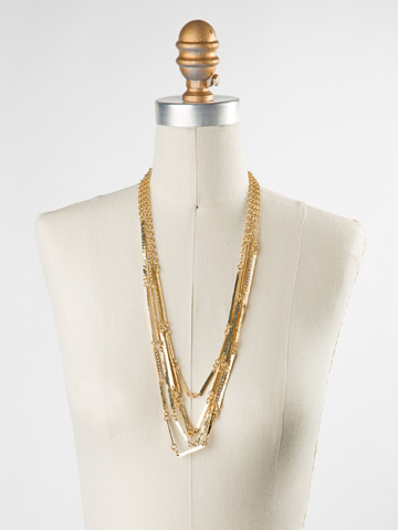 Linked Hammered Metal Multi-Strand Necklace in Bright Gold-tone Crystal displayed on a necklace bust