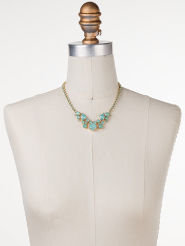 Petite Round Crystal Cluster Line Necklace in Bright Gold-tone Pacific Opal displayed on a necklace bust