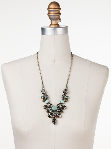 Chambray Statement Necklace in Antique Gold-tone Crystal Patina displayed on a necklace bust
