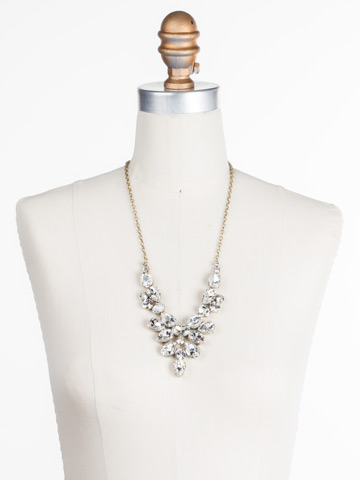 Chambray Statement Necklace in Antique Gold-tone Crystal displayed on a necklace bust
