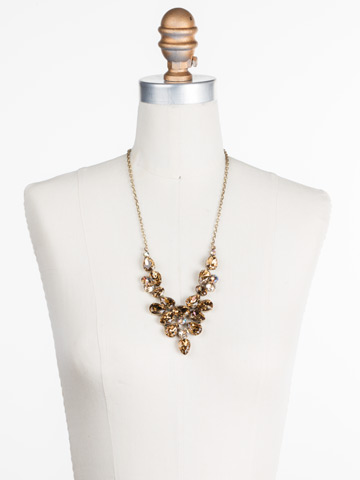 Chambray Statement Necklace in Antique Gold-tone Neutral Territory displayed on a necklace bust