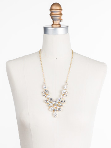 Chambray Statement Necklace in Bright Gold-tone Crystal displayed on a necklace bust