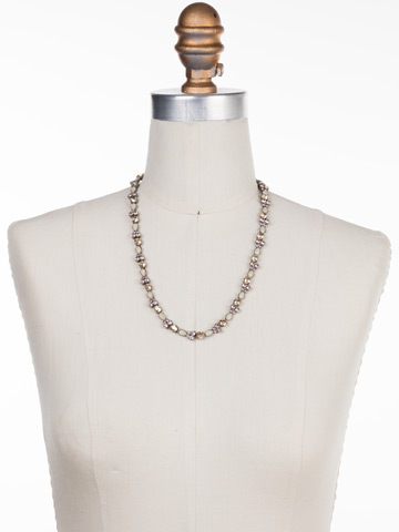 Pear Parade Line Necklace in Antique Silver-tone Satin Blush displayed on a necklace bust