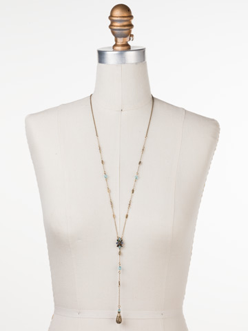 Celestial Filigree Y Necklace in Antique Gold-tone Crystal Patina displayed on a necklace bust
