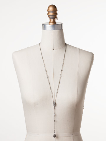 Celestial Filigree Y Necklace in Antique Silver-tone Crystal displayed on a necklace bust