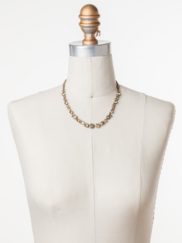 Macrame Line Necklace in Antique Gold-tone Neutral Territory displayed on a necklace bust