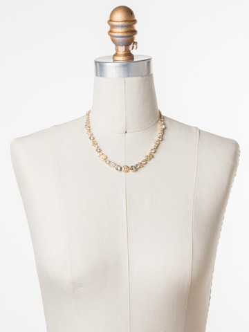 Macrame Line Necklace in Bright Gold-tone Crystal displayed on a necklace bust